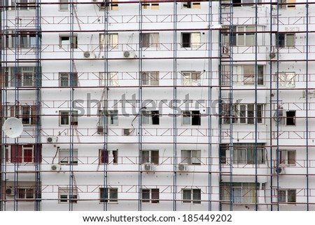 Building covered in scaffolds being rehabilitated - stock photo