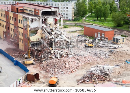 Building demolition and crashing by machinery for new construction - stock photo