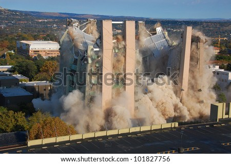 Building demolition by implosion - image 7 of a 10 shot sequence - stock photo