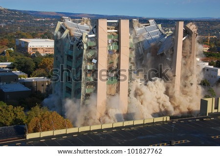 Building demolition by implosion - image 6 of a 10 shot sequence - stock photo