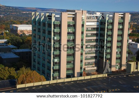 Building demolition by implosion - image 1 of a 10 shot sequence - stock photo