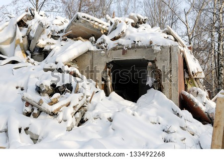 Building destroyed by a earthquake covered with snow