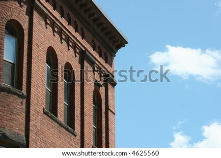 Building detail and blue sky. - stock photo