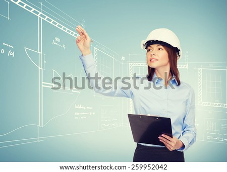 building, developing, consrtuction and architecture concept - smiling businesswoman in white helmet with clipboard pointing finger - stock photo