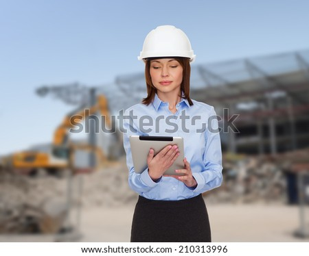 building, developing, construction and architecture concept - smiling businesswoman in white helmet ant tablet pc computer - stock photo