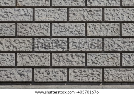 Building Exterior with a Masonry Pattern - stock photo