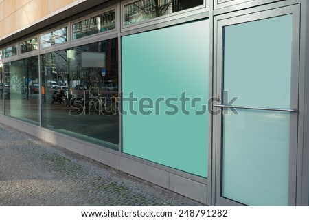 Building Exterior With Glass Window And Closed Door - stock photo
