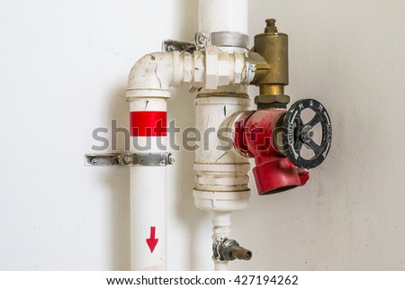 Building fire extinguishing system, water pipe. - stock photo