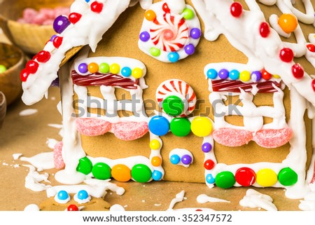 Building gingerbread house for Christmas.