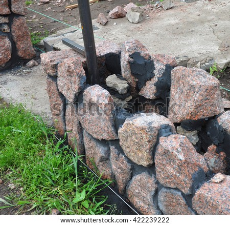 Building Granite Stone Fence with Doorway