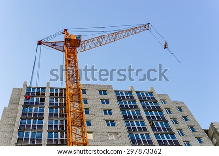 Building High-rise crane and building under construction - stock photo