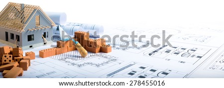 building house - brick and project for construction industry background  - stock photo
