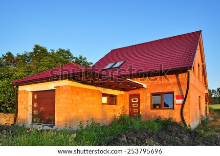 Building house construction with garage. - stock photo
