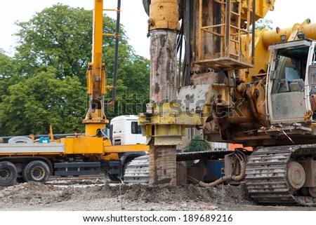 building house foundations with bore pile machine - stock photo