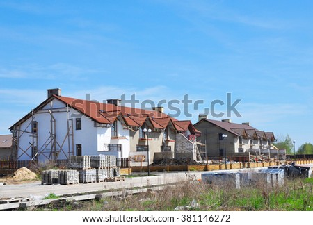 Building House. Modern New Townhouses and Condominiums Housing. - stock photo