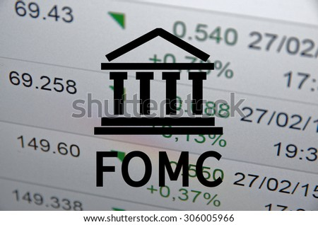 Building icon with inscription FOMC. Financial data on computer  screen. Multiple exposure. - stock photo