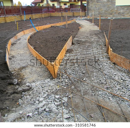 Building new concrete pavement in the garden. Foundation for paving. - stock photo