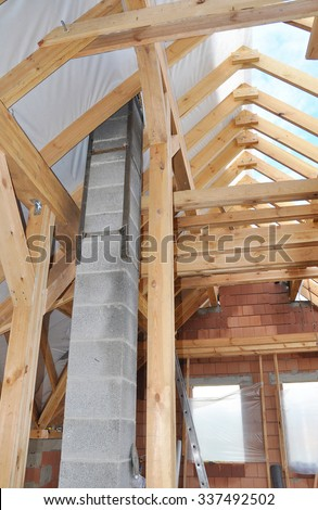 Building New Modular Pumice Stone Chimney Inside of Attic Room and Roof Construction Interior - stock photo