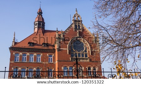 Building of Adam Mickiewicz High School in Katowice, Silesia region, Poland, built in neo-gothic style. - stock photo
