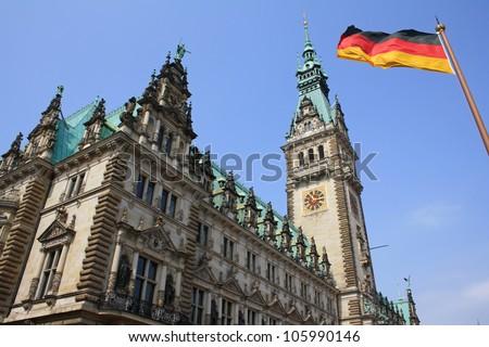 Building of the Hamburg City Hall with german flag - stock photo