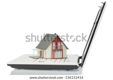 building on computertastaur, symbol photo for real estate and housing market on the internet - stock photo
