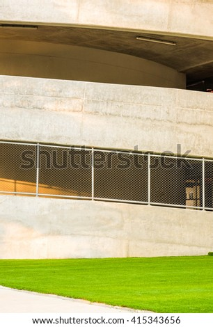 Building parking and green lawn - stock photo