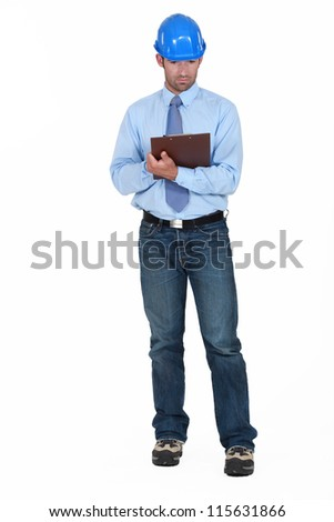 Building planner holding clip-board - stock photo