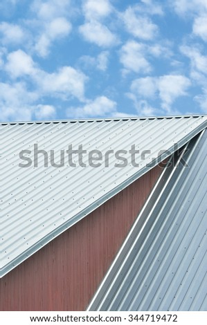 Building roof sheets grey steel rooftop pattern clouds sky rifled roofing large detailed ocher painted wood texture textured background red ochre paint wooden wall vertical gray corrugated metal