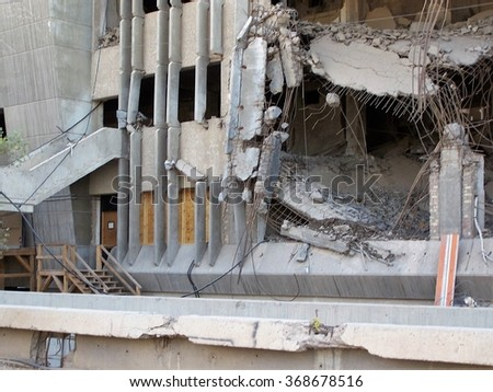 Building seriously damaged by a large blast, with a section with windows boarded up still in use, on a Forward Operating Base in Baghdad, Iraq