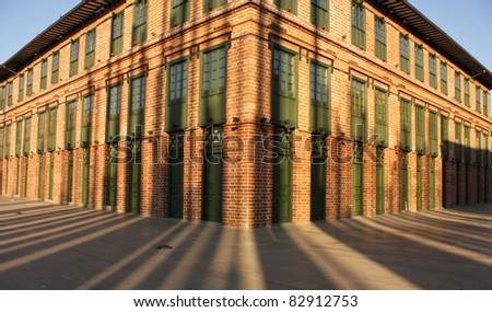 Building shadows. Cisneros square, also called Light square (Plaza de la Luz in Spanish). Medellin, Colombia. - stock photo