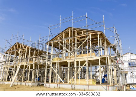 Building site image Wooden construction method of condominiums wooden two-story house - stock photo