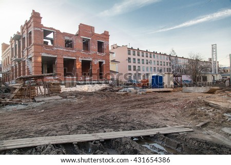 building site of small brick cotage industrial cityscape - stock photo