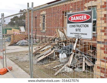 building site under construction with warning sign - stock photo