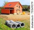 Building site with concrete drain pipe. - stock photo