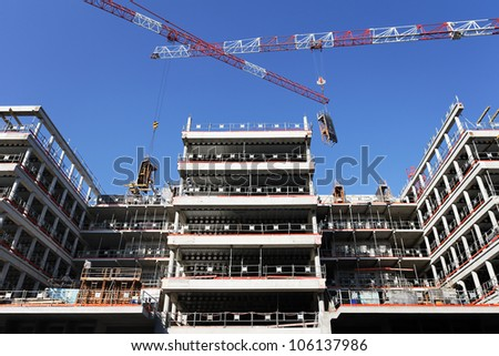 building site with cranes and blue sky - stock photo