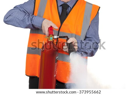 Building Surveyor in orange visibility vest using a fire extinguisher isolated on a white background