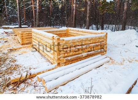 building the house from logs initial stage of the winter forest - stock photo