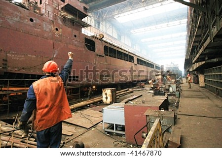 Building the multi-purpose dry cargo sea-river going vessels. - stock photo