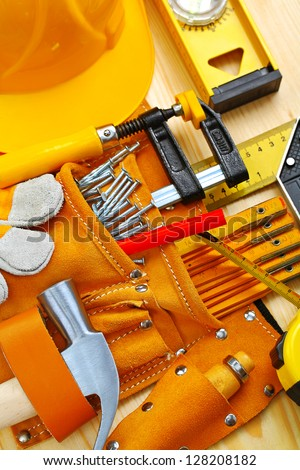 building tools in belt and hardhat - stock photo