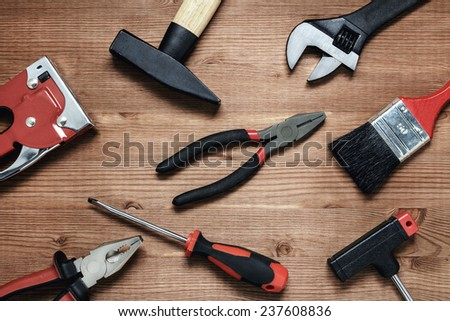 Building tools on wooden surface  - stock photo