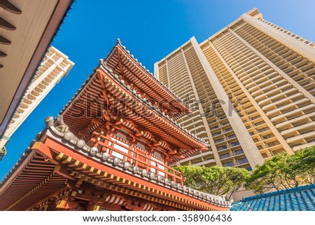 Building tops in Honolulu, Hawaii, USA. Tropical city vacation background. - stock photo