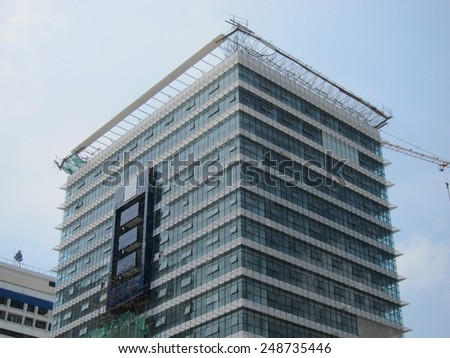 Building under construction over blue sky - stock photo