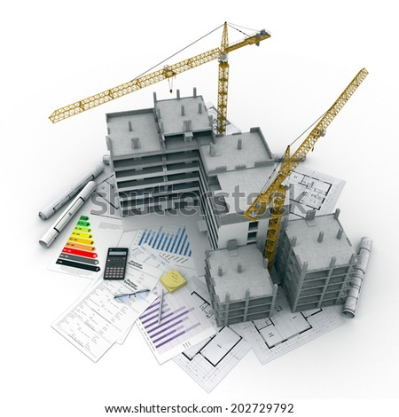 Building under construction with blueprints, bank forms, energetic efficiency charts, and a calculator - stock photo