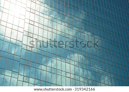Building windows reflection of sunlight sky