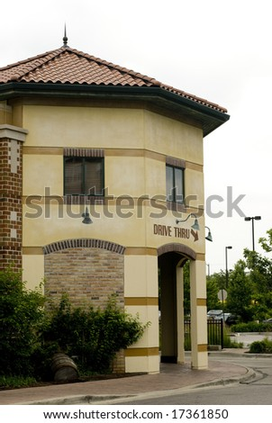 Building with arrow directing drive-thru - stock photo