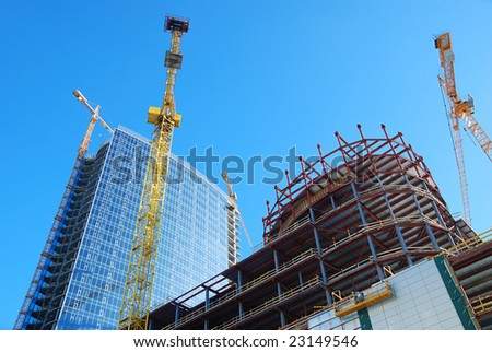 Building with cranes - stock photo