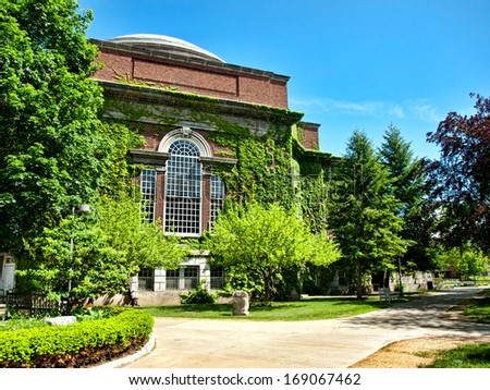 building with ivy and lush greenery - stock photo