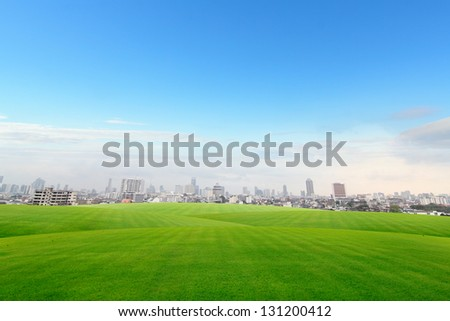 Building with lawn - stock photo