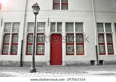 Building with red door and windows in Netherlands