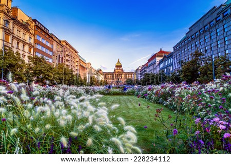 Buildings  and houses in the historical center of Prague. Wenceslas square in Prague in Central Europe: the equestrian statue of Saint Wenceslas and the Neorenaissance National Museum - stock photo